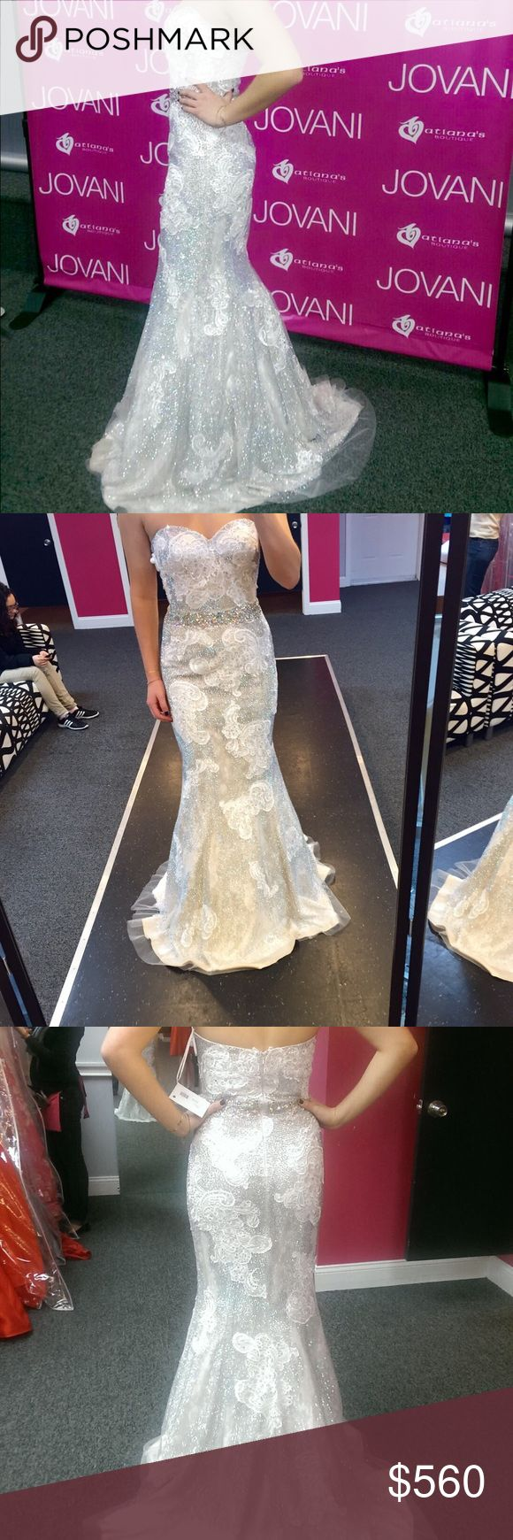 Couture Jovani Wedding/Prom Dress Honestly I don't know the style number of this dress. I got it 3 years ago for my junior prom and it's a REALLY rare dress. They didn't make many of them. It's a size 2 and a completely beaded dress with lace detailing. I'm 5'3 but wore 6-7 inch heels so fits up to 5'9 and 5'10. The dress has many layers..silk, Lace, beading. All in all I spent over $1000 on this dress. It has B cups inserted but they can easily be removed. Jovani Dresses Wedding