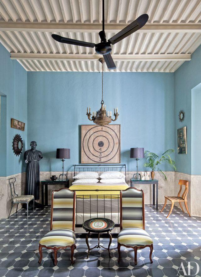 An antique belgian archery target hangs in the guest bedroom of decorative arts dealers robert willson