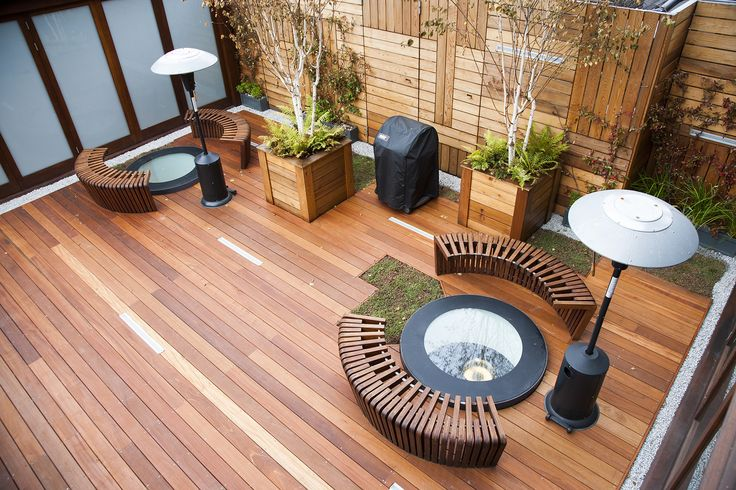 Beautifully engineered seating on a hard wood deck surrounds the sky lights of the building below