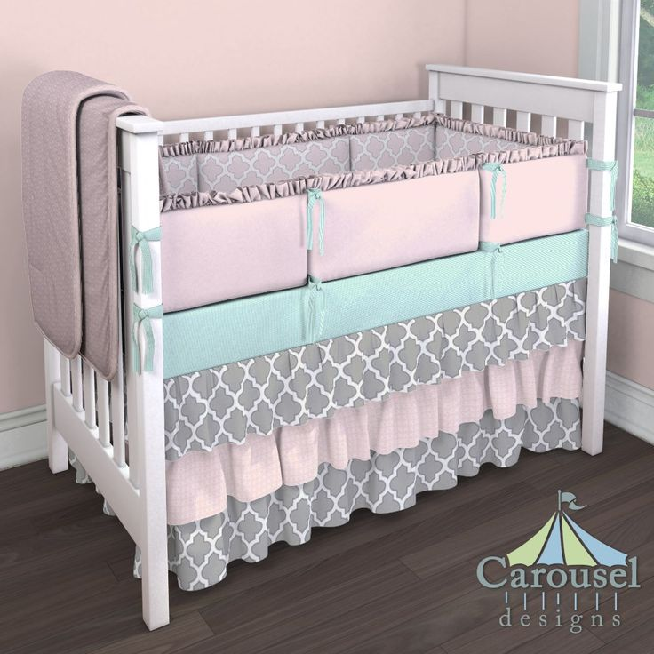 Crib bedding in Mint Mini Stripe, Pink and Navy Quatrefoil, Solid Pink, Pink Circles, Silver Gray and Navy Quatrefoil, Pink Dimpled Minky. Created using the Nursery Designer® by Carousel Designs where you mix and match from hundreds of fabrics to create your own unique baby bedding. #carouseldesigns