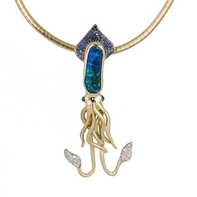 Here's something a little bit whimsical for your weekend! Yellow gold custom squid pendant with emeralds, diamonds, sapphires, and opal!