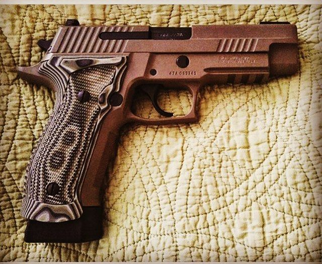 Sig P226 Tac Ops in 9mm 20+1 Capacity Houge G10 Grips SRT Trigger  Manufacture- @sigsauerinc @sigsauerusa  Photo taken by- @rud12c  #sig #sigsauer #sigp226 #p226 #handgun #pistol #shooting #9mm #army #marines #navyseals #military #police #gun #guns #1776 #1776united #2a Save those thumbs & bucks w/ free shipping on this magloader I purchased mine http://www.amazon.com/shops/raeind  No more leaving the last round out because it is too hard to get in. And you will load them faster and easier…