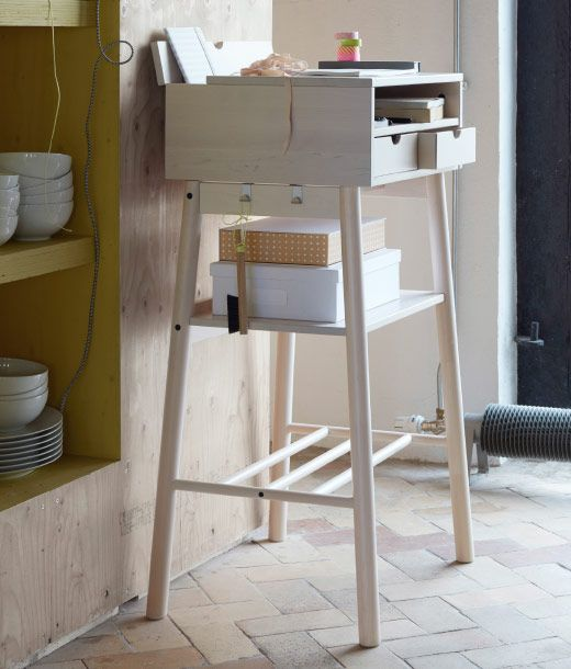 A standing desk in solid wood with space for laptop, chargers, calendars, mail…