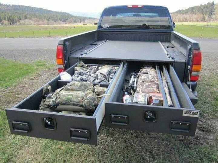 Pickup truck bed organizer with sliding drawers