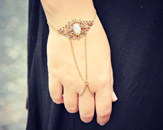 pink opal ornate filigree slave bracelet ring by alapopjewelry, $25.00 also stunning, though blue fire opal would be prettier with silver