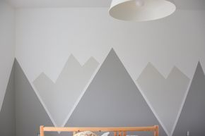 Looking for an amazing kids room or nursery decor idea? DIY this painted mountain range mural - easy and budget friendly! Perfect for a graphic, black and white, camping, adventure style room. Head on over to the blog for the full how-to tutorial.