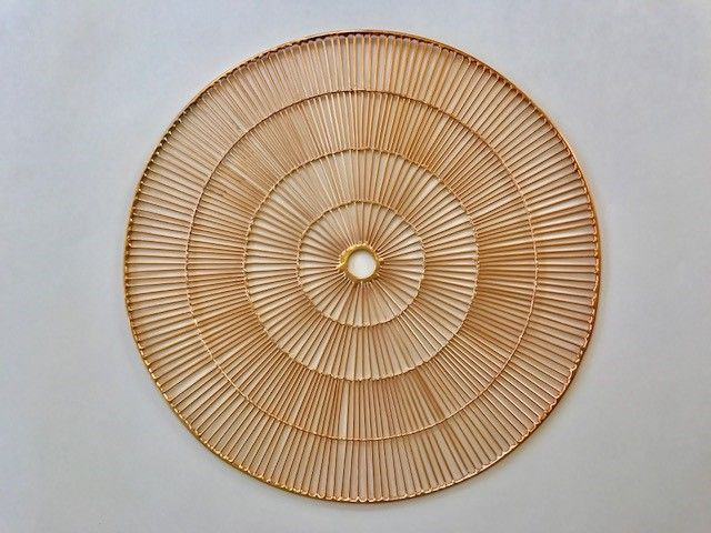 Round Copper wire placemat in a spoke pattern. Modern charger plate.