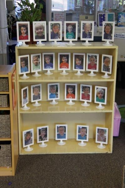 Framed photos of each child with an individual photo on one side and a photo of them involved in a group activity on the other ≈≈