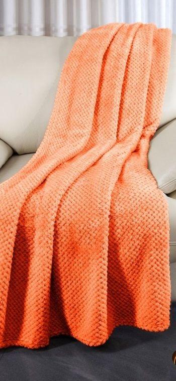 Měkký přehoz na sedací soupravu v oranžové barvě