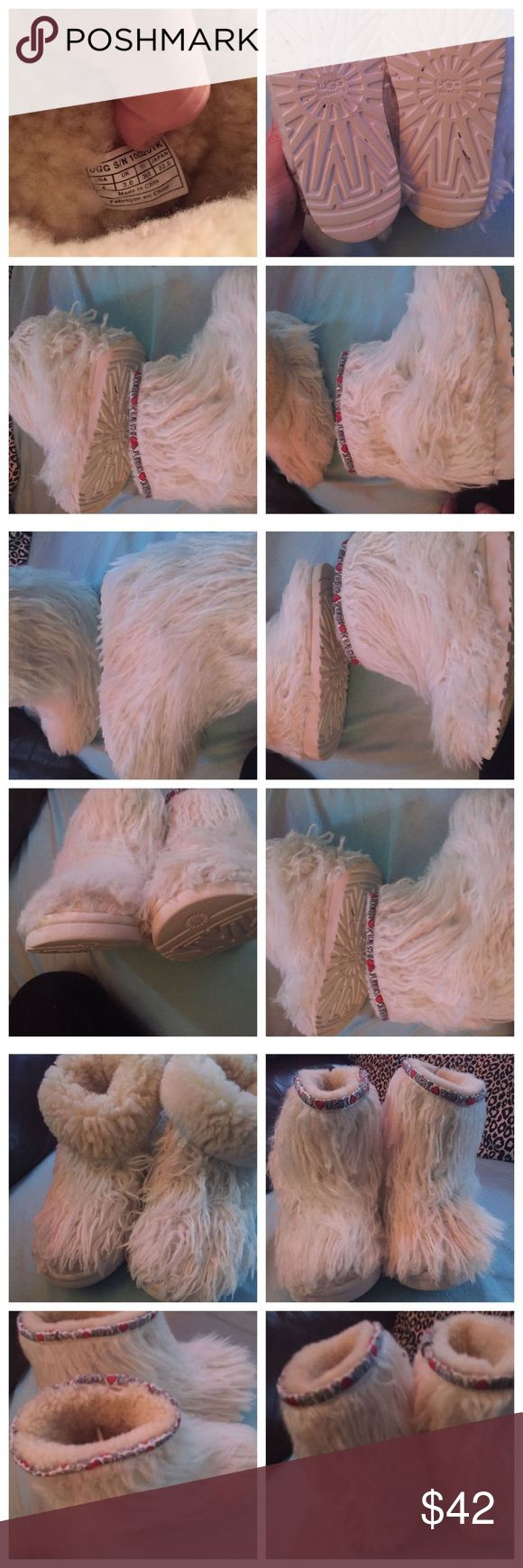 """Size 4 uggs, white long hair. White long hair ugg boots.  """" Mongolian"""" hair ugg boots. These are size 4/ USA 4     Bought these about 3 years ago.  I brushed the hair on the boots so you are able to see the accurate description. The front/side.  These are short and inside is """" genuine sheep skin."""" Eva molded and """" ugg"""" logo on the bottom sole of the boots. Going around the top of the boot  """" black, red & writing"""" It says """" I ❤ugg."""" I took pictures of the labesninside the boots.  Smoke free…"""