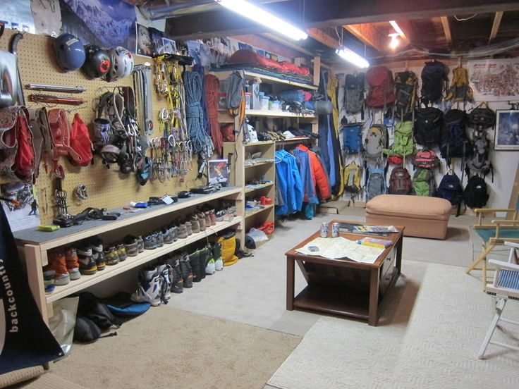 Gear storage/trip planning room - peg board hooks, low hanging coats with shelf above and sleeping bags next with high hanging bar.