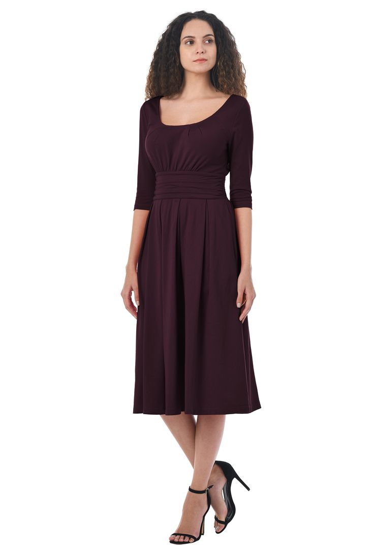 Our cotton jersey knit dress gives you a long and fit-and-flare look with soft ruching nipping in the inset waist.