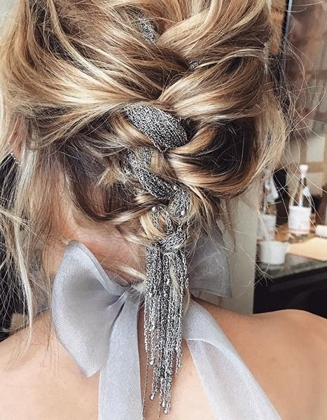 For this year's SAG Awards, celebrity hairstylist Adir Abergel wove a silver chain into The Crown actress' braided updo.