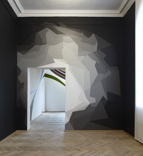 Geometric painting on the wall, looks like a top of a hill