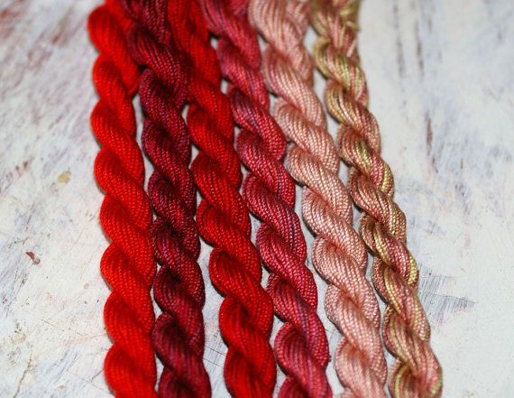 Silken Pearl #5 is a 100% Silk thread with a tight twist similar to a pearl cotton which is hand dyed by us. You are purchasing 1 skein of this thread. Choose from the variable, drop down menu. Colors from L to R are: Pagoda Red, In the Burgandy, In the Reds, Rose Briar, Rose Blush and Dried Roses. Skeins are 15 yards each. A beautiful thread for wool applique, needlepoint and quilt embellishement, or cross stitch on 18 count linen. This is my favorite thread to use for bullion knots…