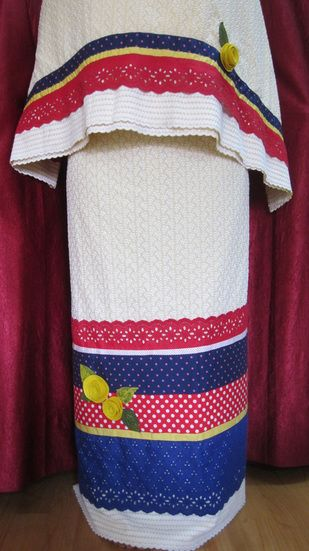 Light yellow self embroidered fabric with colored cotton laces and hand made flowers for a classy look. http://feisa.weebly.com/ridas.html