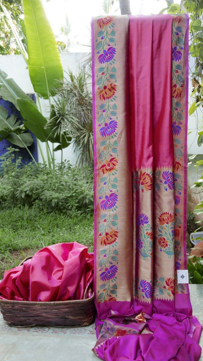 This hot pink and purple chequered Benares silk is a unique sari. The border and pallu are in purple with gold zari and meena work making it an admirable piece
