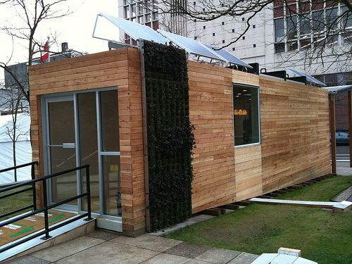 This is the Home of the Future, which is on display at the BC Hydro Power Smart Village in downtown Vancouver. It's hard to tell, but the home is actually made with two shipping containers and wrapped in cedar and pine beetle wood cladding. In addition, according to a press release, the showcase project is…