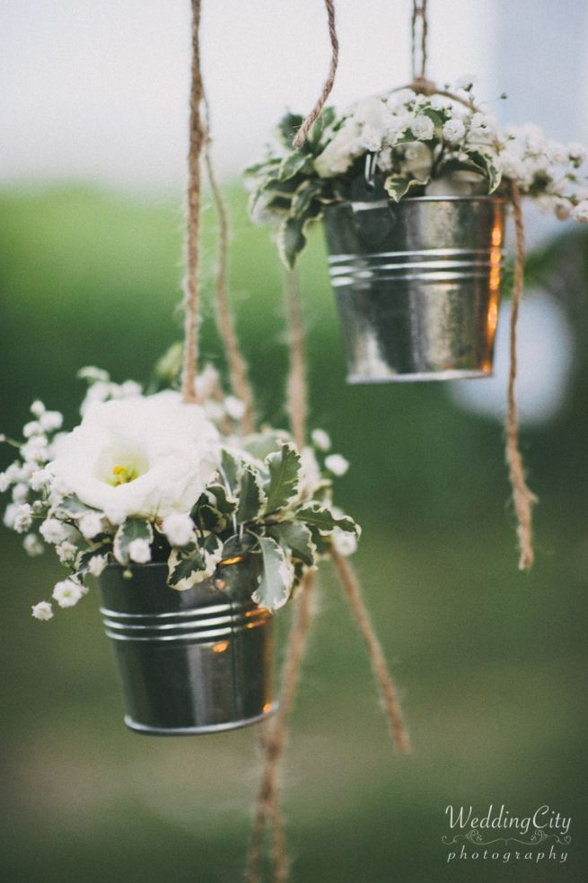 10 Ways to Use Wood Planters and Metal Buckets in Your Wedding