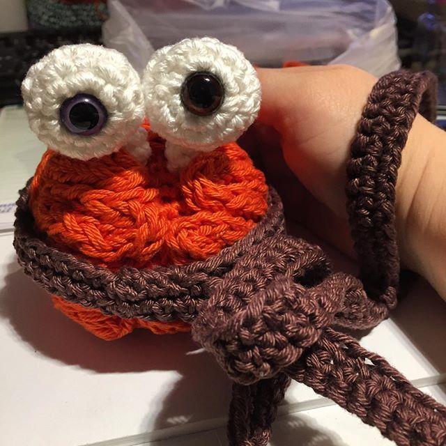 This is Zombray. Zombie brain on a leash.  #zombie #crochet #brainonaleash #orange #brown #brain #purple #eyes #zombray #amigurumi #desucon11