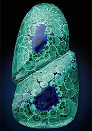 Azurite Malachite - Azurite is one of the two basic copper carbonate minerals, the other being bright green malachite. http://en.wikipedia.org/wiki/Azurite