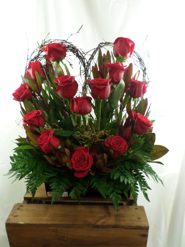 Red roses in a heart shaped design. Table arrangement. Created by Florist ilene