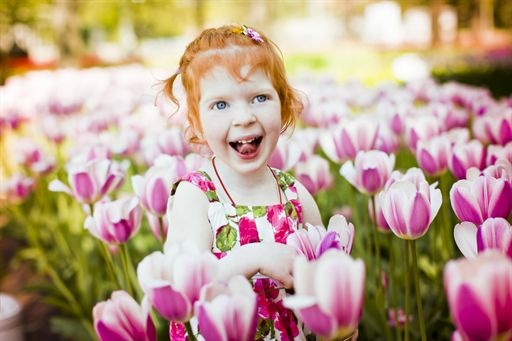 Kids spring picture ideas.  Little girl sitting in a field of tulip flowers