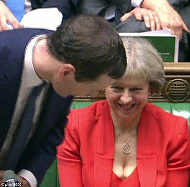 Eyeful: A lacy bra peeking out from underneath her red dress, the Home Secretary Theresa M...