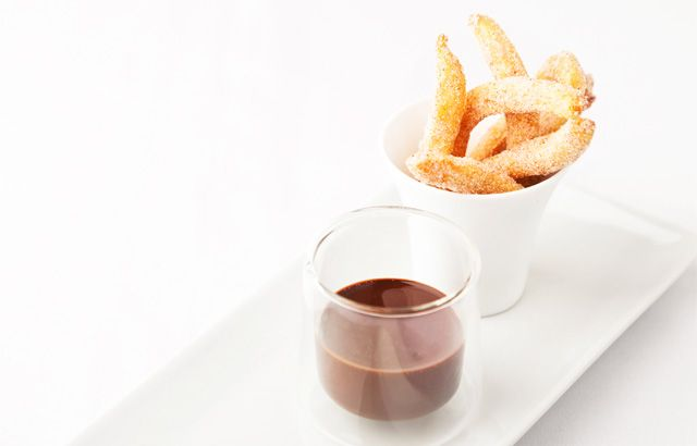 Cinnamon doughnuts and chocolate sauce by Kevin Mangeolles