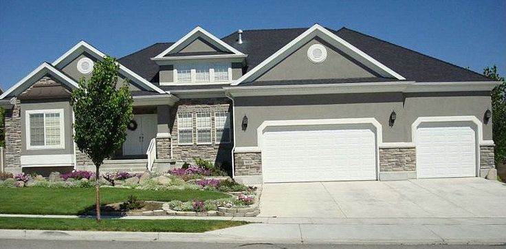 Gray Stucco with rock accent and white trim. Goes well with the dark roof.                                                                                                                                                                                 More