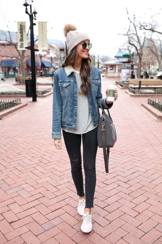 Super cute jean jacket for Fall paired with darker denim, white sneakers, and a beanie with a little poof on the top. #FallStyle