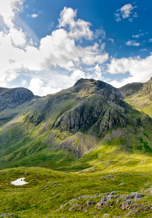 Scafell Pike, Lake District, England - I climbed this mountain in July 2009, as part of the national 3 Peaks Challenge. This challenge, and in particular, this mountain due to the dismal weather conditions on the day, was both the best and worst thing I have done, simultaneously. Loved it!
