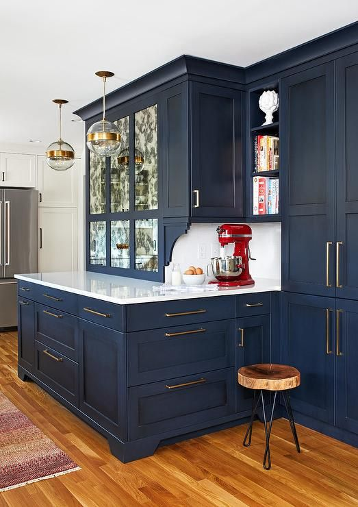 Contemporary kitchen does not hesitate to add cool tones in the cabinetry finish offering a retreat-like feel.