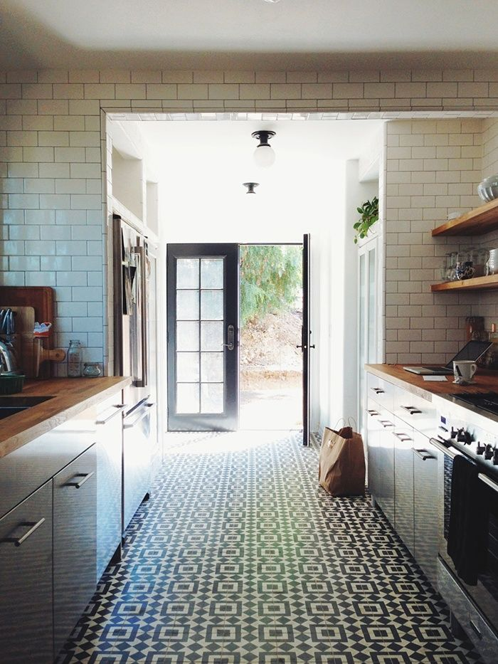 Neutral white modern kitchen with wood counters, subway tile and ...