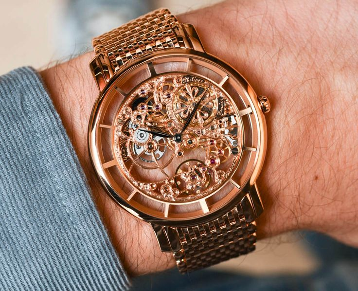 We're hands on with the Patek Philippe Calatrava 5180/1R Skeleton watch.  A full gold skeletonized watch.