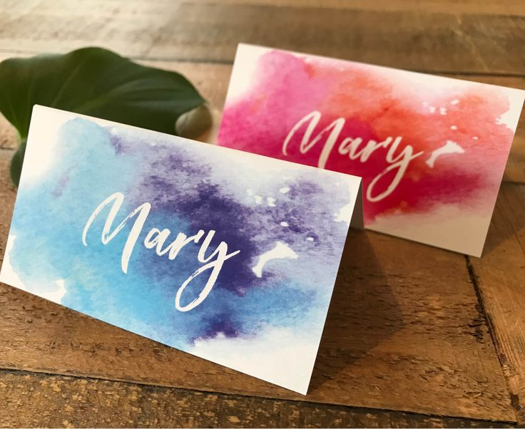 A set of gorgeous watercolor | watercolour ombre place cards | tent cards | escort cards with blue and purple or pink and orange watercolour | watercolor. Place cards are completely customisable and can be used for any occasion.