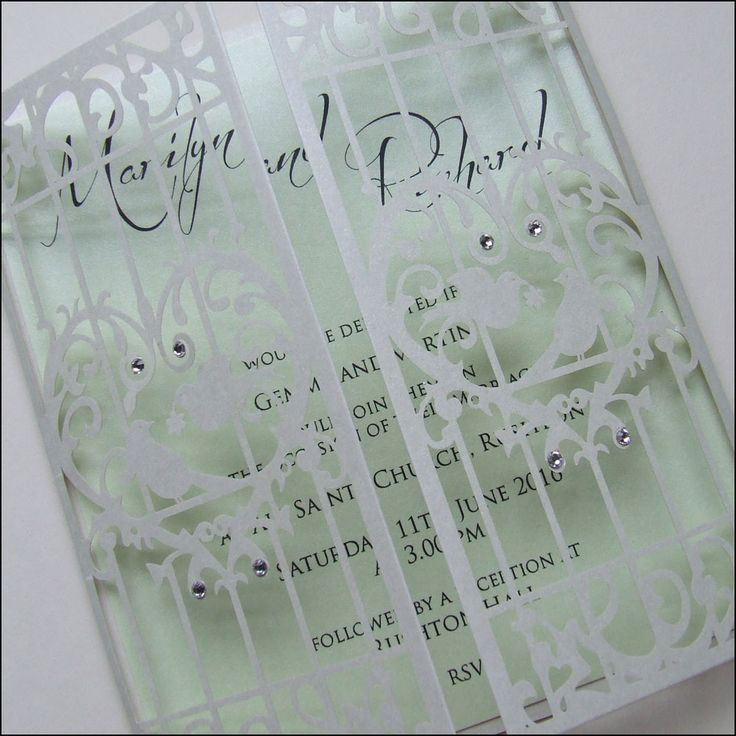 This laser cut gatefold style wedding invitation is features love birds and crystals. The insert is available in many colours.