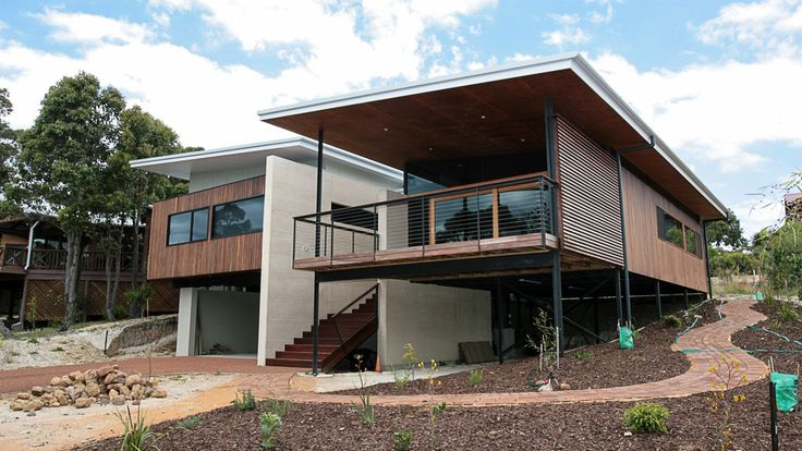Country Style Holiday Home, Spotted Gum Cladding, Jarrah decking, Jarrah hand rails, stainless steel balustrading, timber patio ceiling, architecture