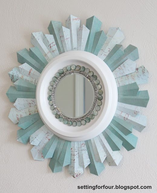 See how I made a budget friendly, gorgeous DIY sunburst mirror from a ceiling medallion and scrapbook paper! You won't believe how stunning this turned out!