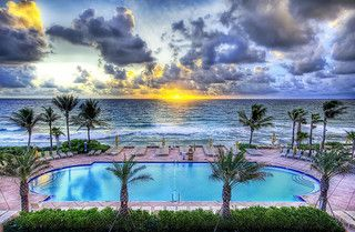 There's a pool party at sunset - everyone mark your chair with a towel | Flickr - Photo Sharing!