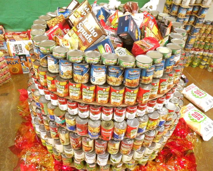 The Department of Child Support Services collected 1000 pounds of food. Their display depicts a stone soup pot sitting atop a fire.
