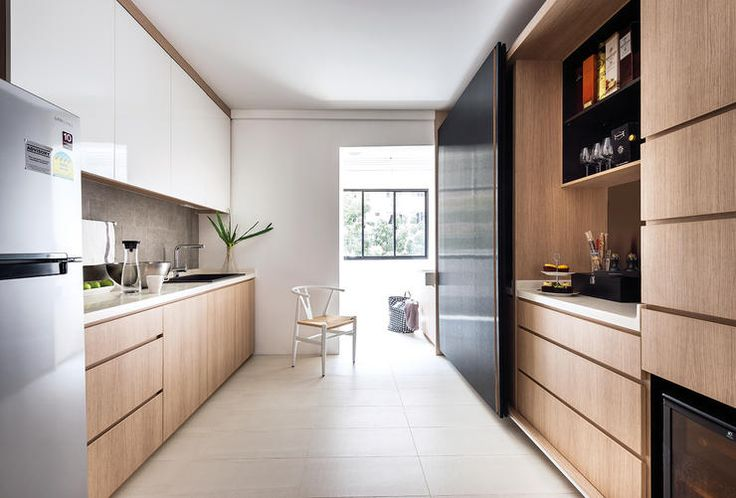 Interior designer, Mike, planned a wide, spacious look for the kitchen, with cabinet on opposite sides of the space.