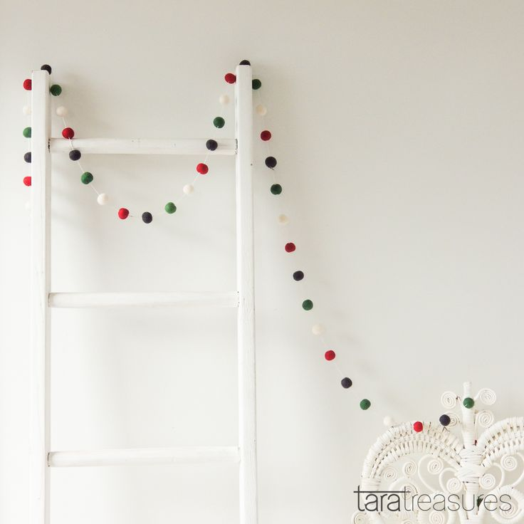 """Felt ball garland to add a """"smile"""" to any room. Drape this Christmas felt garland around windows, mantels, tepees and even treehouses. Whimsical yet simple, a perfect gift for any age. #feltballgarland"""