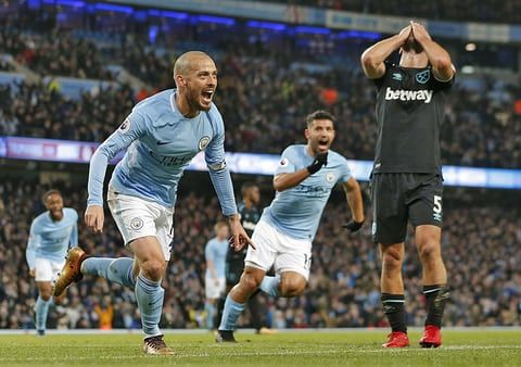 David Silva of Manchester City scores the 2nd city goal as he runs past distraught Pablo Zabaleta of West Ham United during the close 2 v 1 victory at the Etihad Stadium.