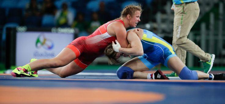 Canada's Erica Elizabeth Wiebe, red, competes against Kazakhstan's Guzel…