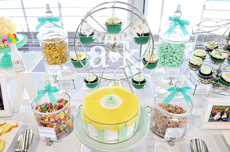 Pastel Green and Yellow Carnival inspired desserts for Adrian's Naming Day. Cakes by Chef A.