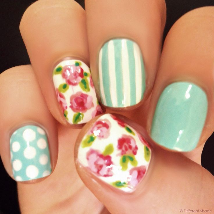 Loving the floral print mixed with stripes and polkadots. So classy, cute and perfect for Spring. #springnails #floral