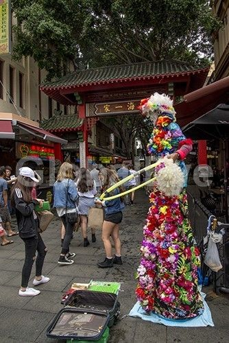 Street performer Chinatown Sydney. A street performer at the entrance to Sydney's Chinatown. Photograph By Noel   Fisher #PeoplePhotography