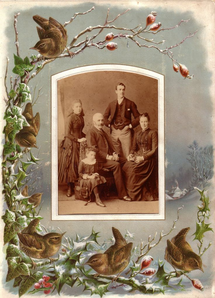 heaveninawildflower: Winter scene of wrens, holly and ivy from a Victorian photograph album which surrounds a photograph of a Victorian family. The little girl is holding a skipping rope. Own scan from original album.