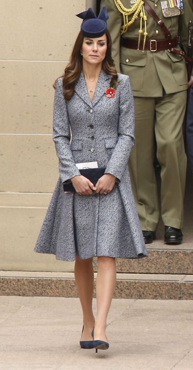 April 25, 2014 - While Kate Middleton didn't wear a much anticipated gown for her finale look, she did say goodbye with a sartorial bang. For the Duchess' and Prince William's visit to the Australian War Memorial in Canberra, Kate opted for a respectfully elegant tweed coat dress from the Michael Kors spring 2014 collection. She accessorized with a hat by Jonathan Howard, an Aussie milliner, and matching Russell & Bromley navy pumps and a clutch.